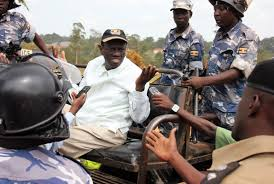 Besigye seen here in a previous fracas with the police