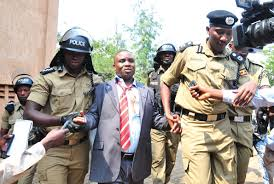 Erias Lukwago being dragged by the police