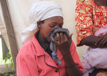 A lady weeps at Mulago Hospital