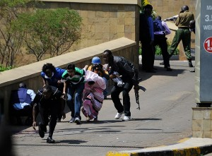 Survivors flee from the scene. AFP Photo