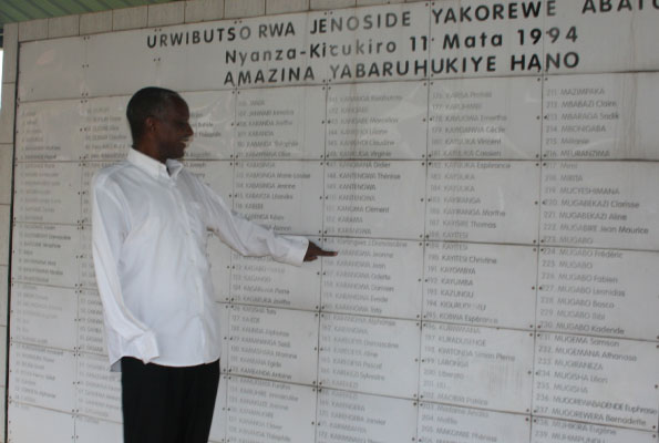 Venuste Karasira points at the list of people who were killed in Nyanza, Kicukiro District in Rwanda. He is among the people who survived that mass killing. PHOTO BY FAUSTIN MUGABE