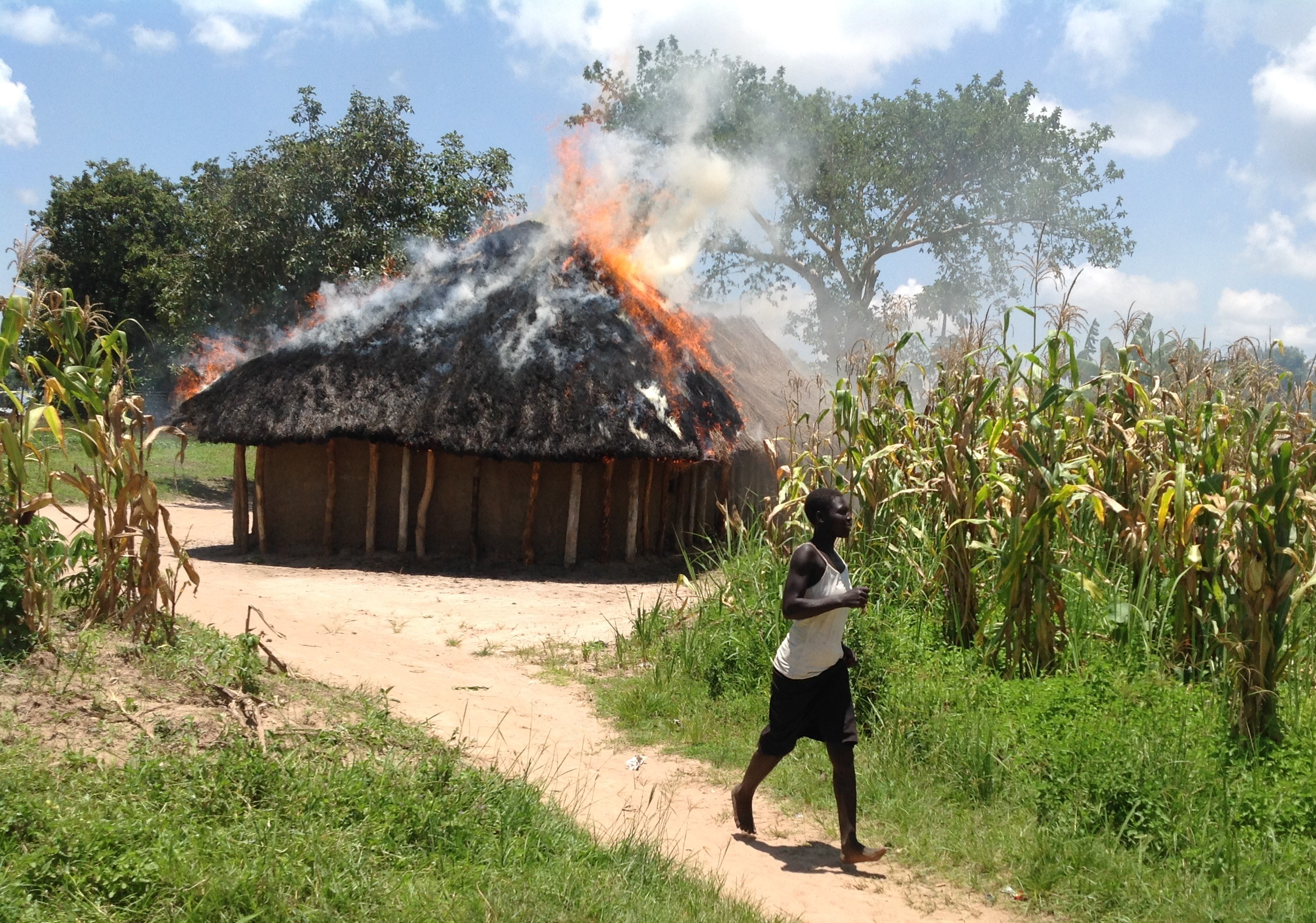 An unidentified woman takes off from a Pentecostal church belonging to South Sudanese that was burnt on Monday during protest