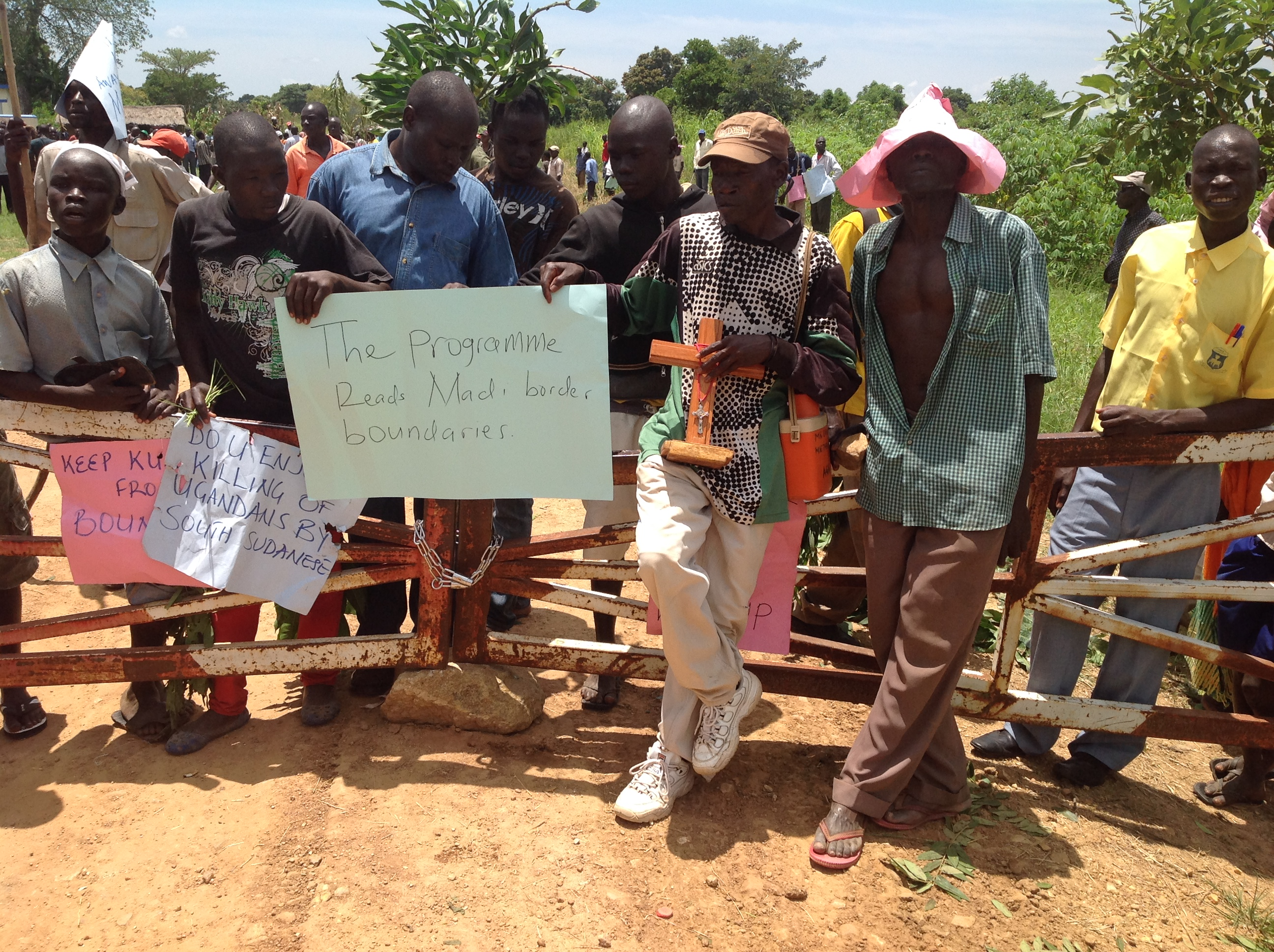 Some of the protestors after closing Afoji border post on Monday. PHOTO BY MARTIN OKUDI.