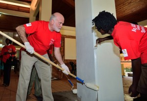 US Ambassador, Scott Delisi and Mildmay Uganda ED, Dr. Barbara Mukasa painting the reception area at the center