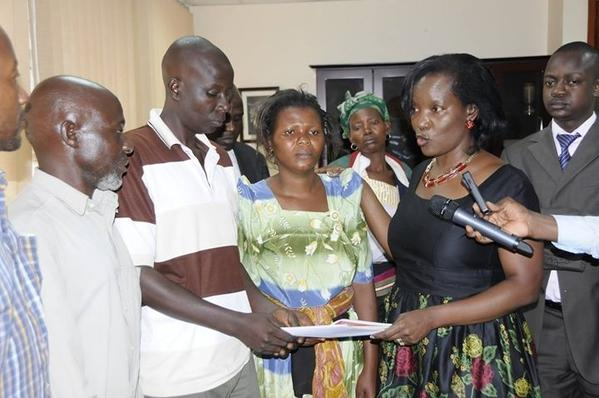 KCCA boss and dead child's parents earlier