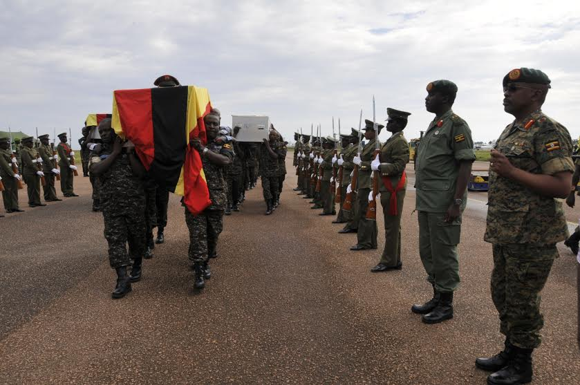 L-R Brig Leopold Kyanda and Maj Gen David Muhoozi in a parade to honour and receive the fallen Uganda peacekeepers. (Courtesy UPDF)