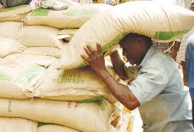 Man packing sugar sacks