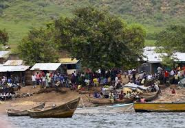 Residents gather to watch as bodies are retrieved from Lake Albert in 2014 (Courtesy Reuters)