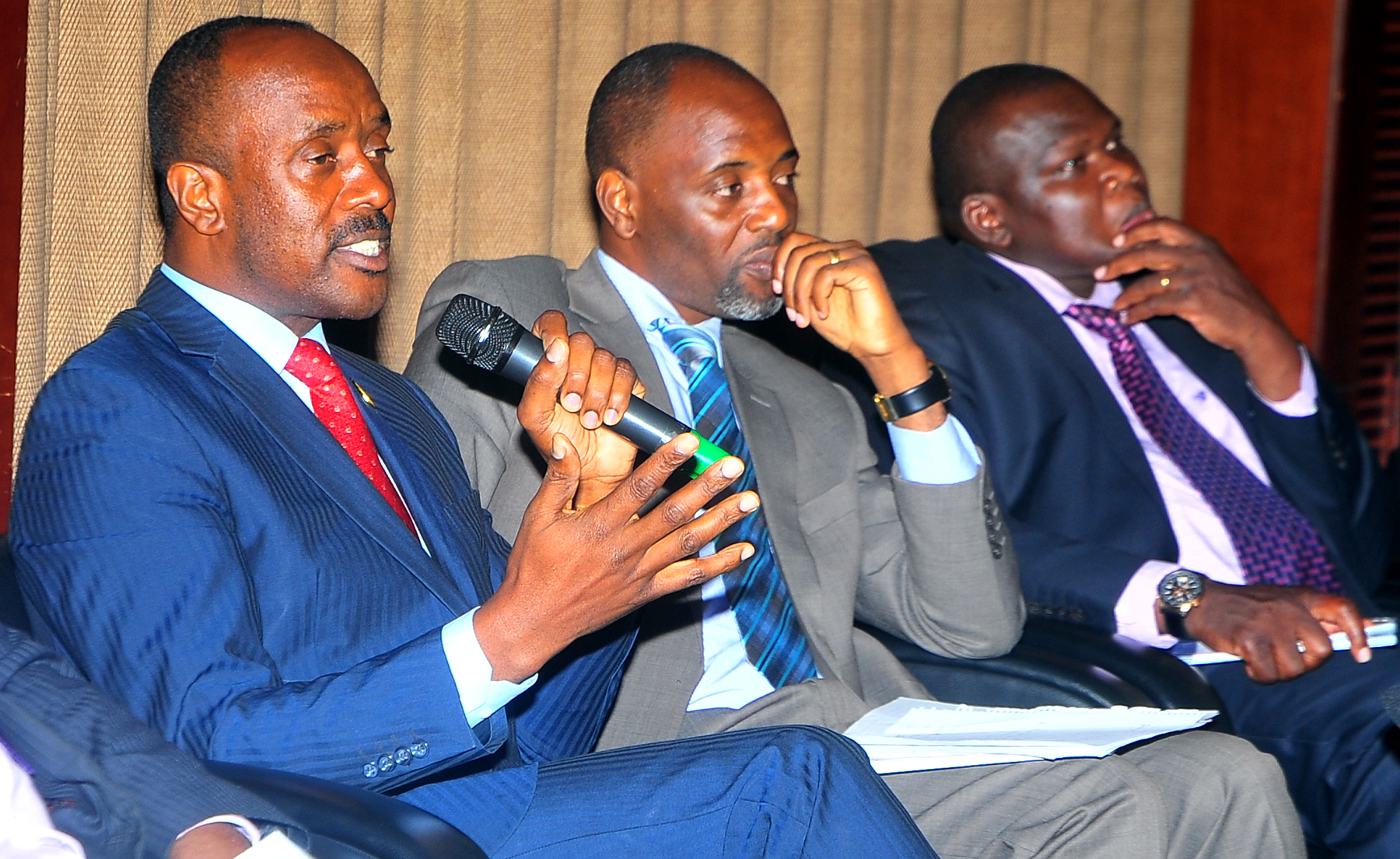 Minister for Economic Monitoring Mr. Henry Bayenzaki (L), National Planning Authority executive director and Member of Parliament for Bulisa Mr. Joseph Muvawala (R) and Stephen Mukitale Birahwa at launch of World Bank fifth Uganda economic update on Tuesday March 3, 2015 at Kampala Serena Hotel.  (PHOTO: STEPHEN WANDERA)
