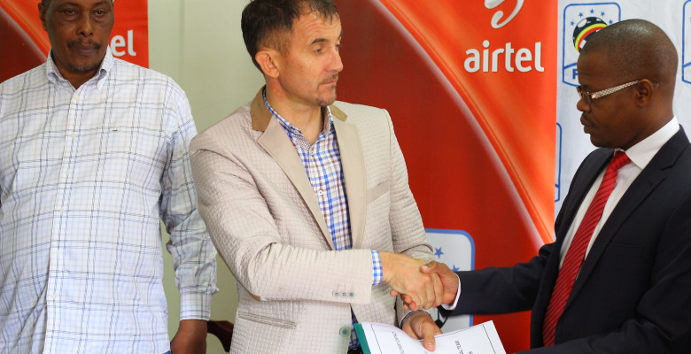 Micho with FUFA president after signing the contract in Mengo