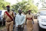 Thomas Kwoyelo (in handcuffs). Internet photo.