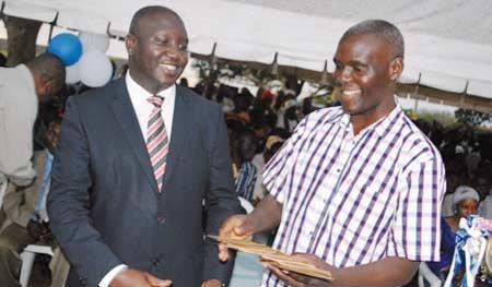 Mulindwa (on the Left) giving Lubyayi money (FILE PHOTO)