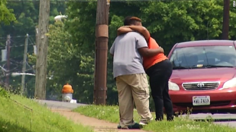 People grieve outside the Roanoke home where a 10-year-old fatally shot an 11-year-old Thursday May 26, 2016.