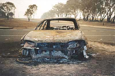 The occupants of this car had gone to the aid of a friend to help evacuate their home in Chapman, when the firestorm hit. As they rushed to escape in the car, it  caught fire and they had to run for their lives. photo: Christine Ashley-Coe