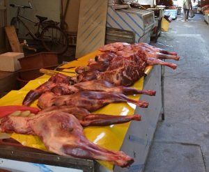 "Photographer Mark Lloyd Features   7.2.02 Pictures of dog meat for sale at Daegun Market Place.Korea. The meat could be baked and then eaten.Or Cooked in a preassure cooker and pressed into ""Gesoju""(dog tonic) The korean tradition of eating dogs is believed to ward of ill health and give men fertility."