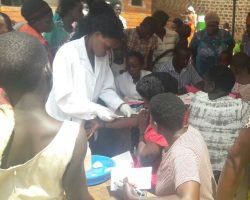 Women Receive Condoms At Health Camp