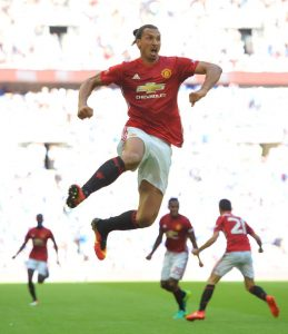 Manchester United's Swedish striker Zlatan Ibrahimovic celebrates scoring their second goal during the FA Community Shield football match between Manchester United and Leicester City at Wembley Stadium in London on August 7, 2016. / AFP PHOTO / GLYN KIRK / NOT FOR MARKETING OR ADVERTISING USE / RESTRICTED TO EDITORIAL USEGLYN KIRK/AFP/Getty Images