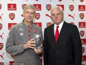 Arsenal chairman Sir Chips Keswick poses with Wenger