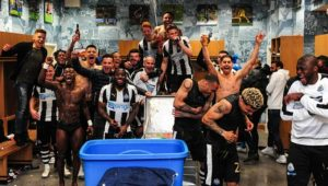 Players Celebrate promotion in the dressing room
