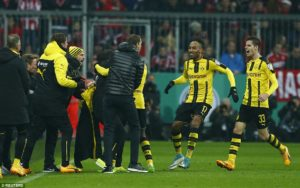 The Dortmund players ran towards the bench to celebrate Dembele's goal