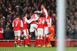 Arsenal Players celebrate after Nacho Monreal's deflected shot ended up in the back of the net