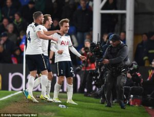 Eriksen is joined in celebration by Toby Alderweireld and Harry Kane after netting in the 78th minute of the game