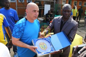 KCCA honoured AlMasry coach & Egypt legend Hossam Hassan with a KCCA FC shield before the game.