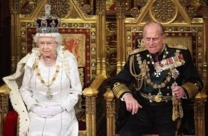 Britain's Queen Elizabeth waits to read the Queen's Speech to lawmakers in the House of Lords, next to Prince Philip, during the State Opening of Parliament in central London May 9, 2012.